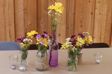 Simple, country flowers in mason glasses